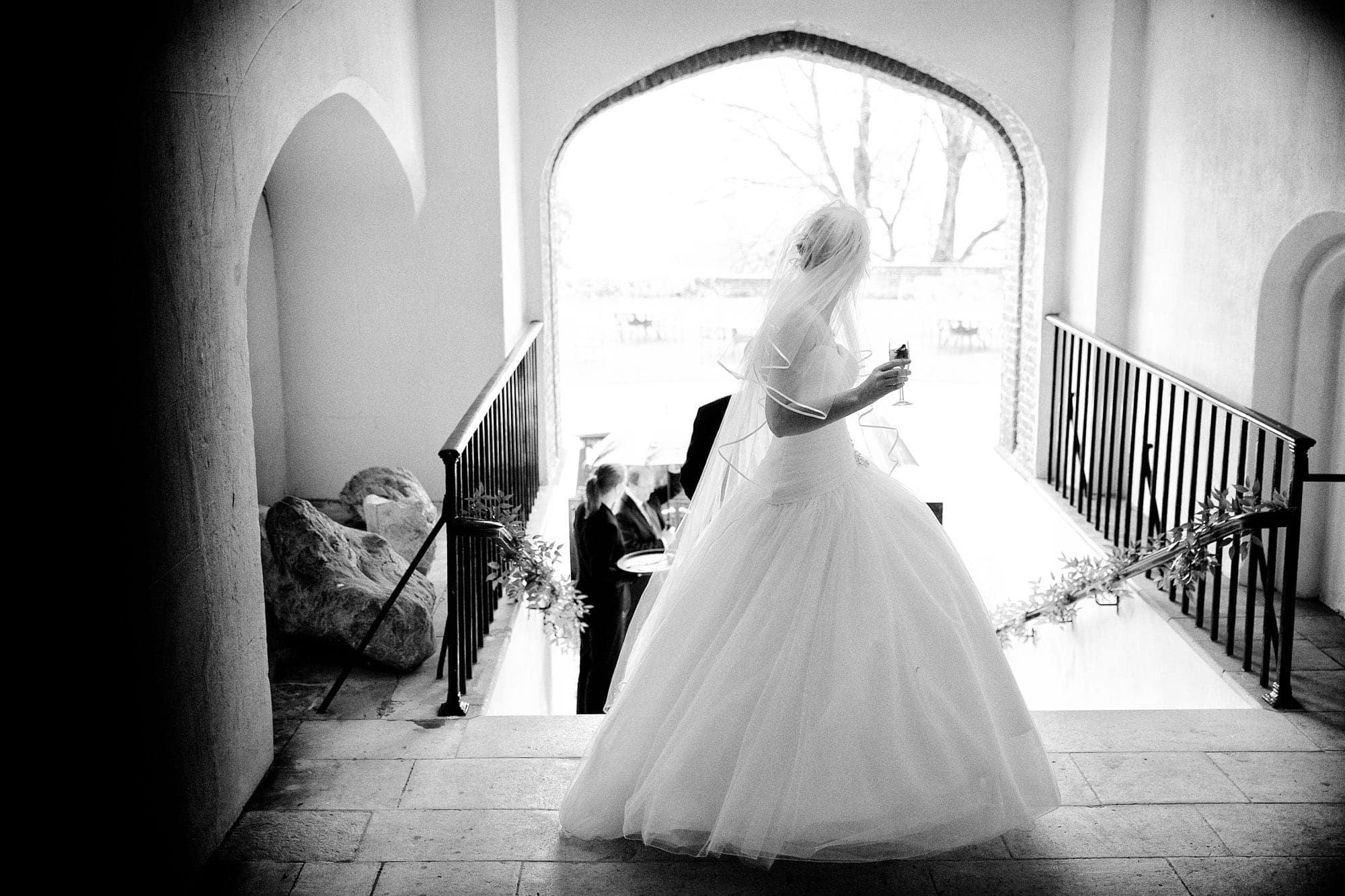 Farnham Castle Wedding Photography - Bride in the Archway at Farnham Castle