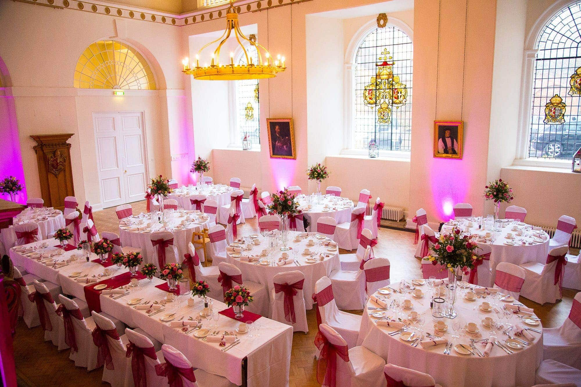 The Great Hall at Farnham Castle Wedding Purple Uplighters, Purple Theme