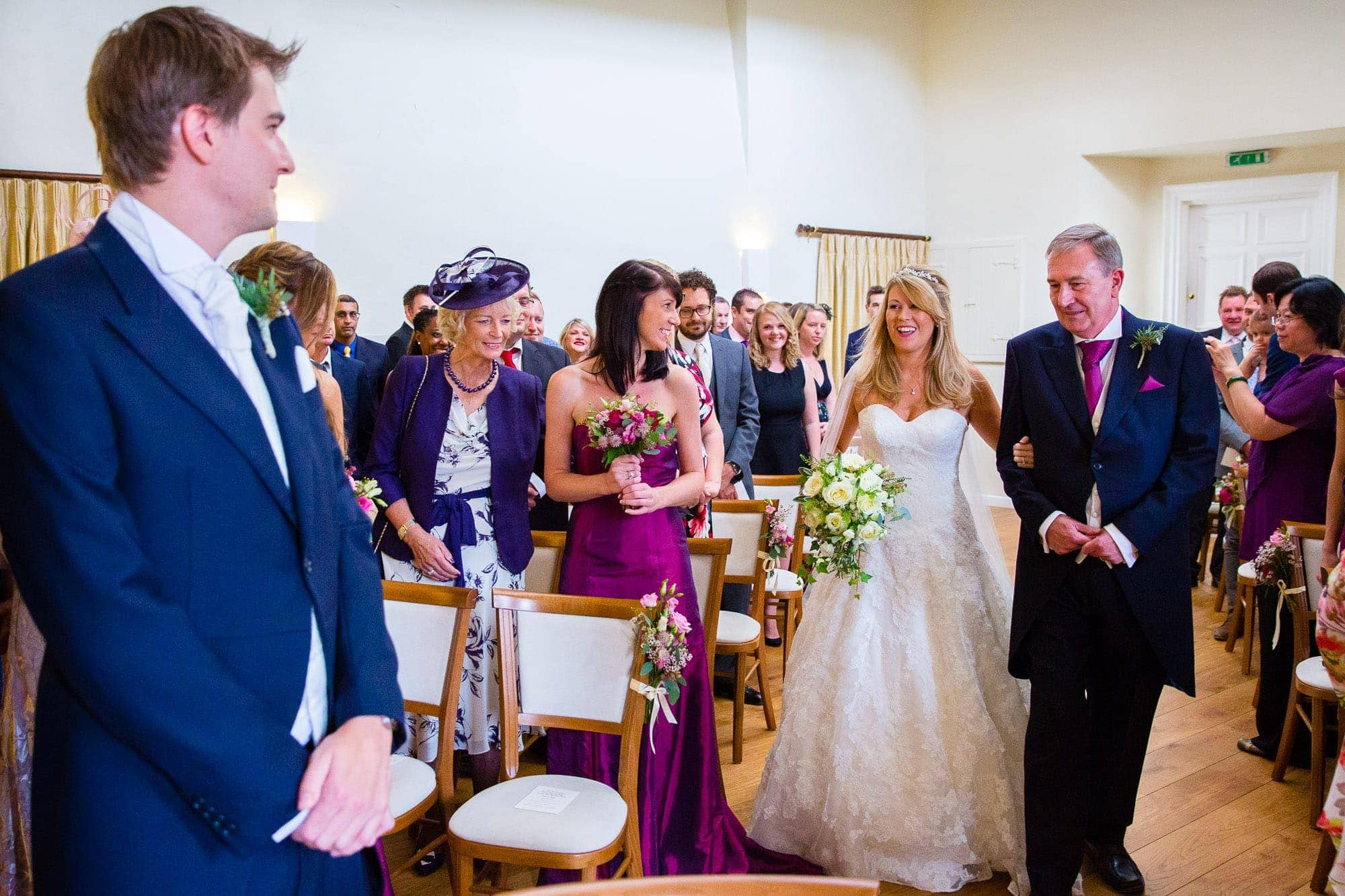 Bride and father walking down aisle at the Lantern Room - Farnham Castle Wedding
