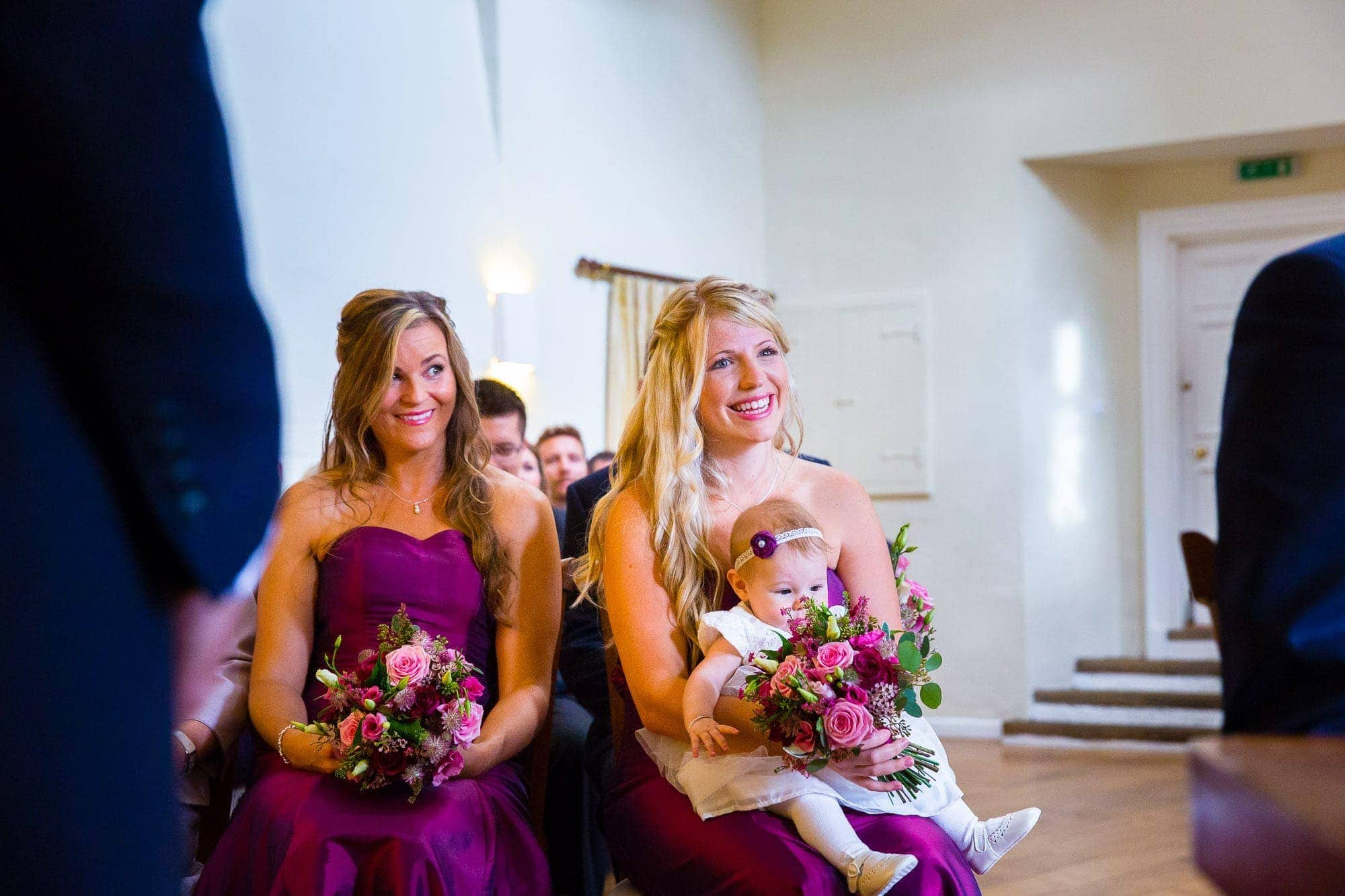 Bridesmaids with baby on lap