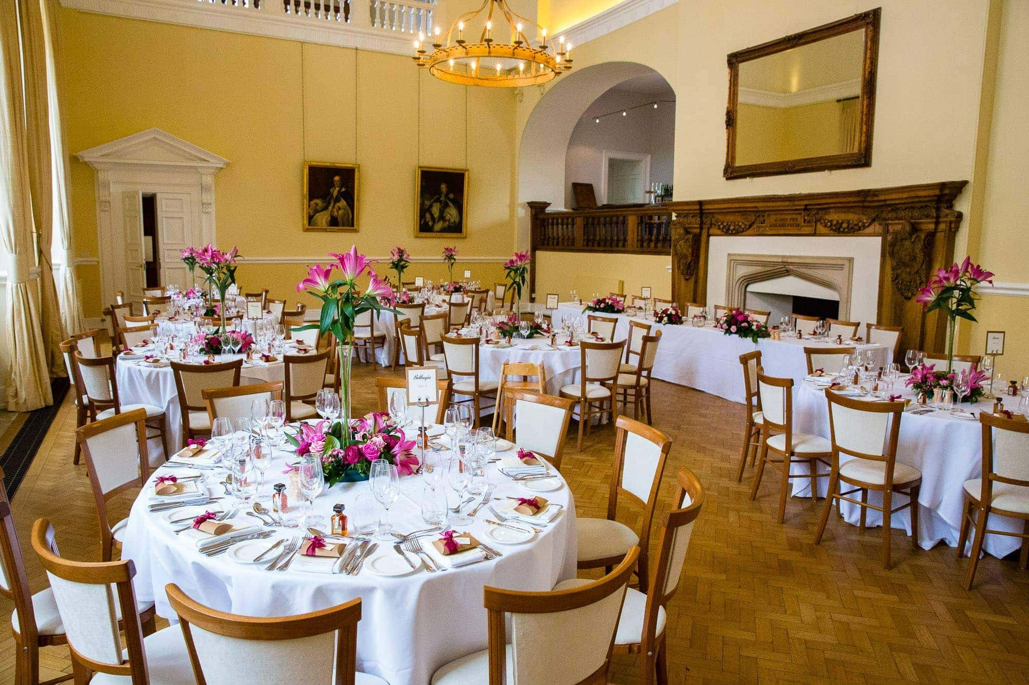 Farnham Castle Great Hall set up for wedding with pink flower decorations