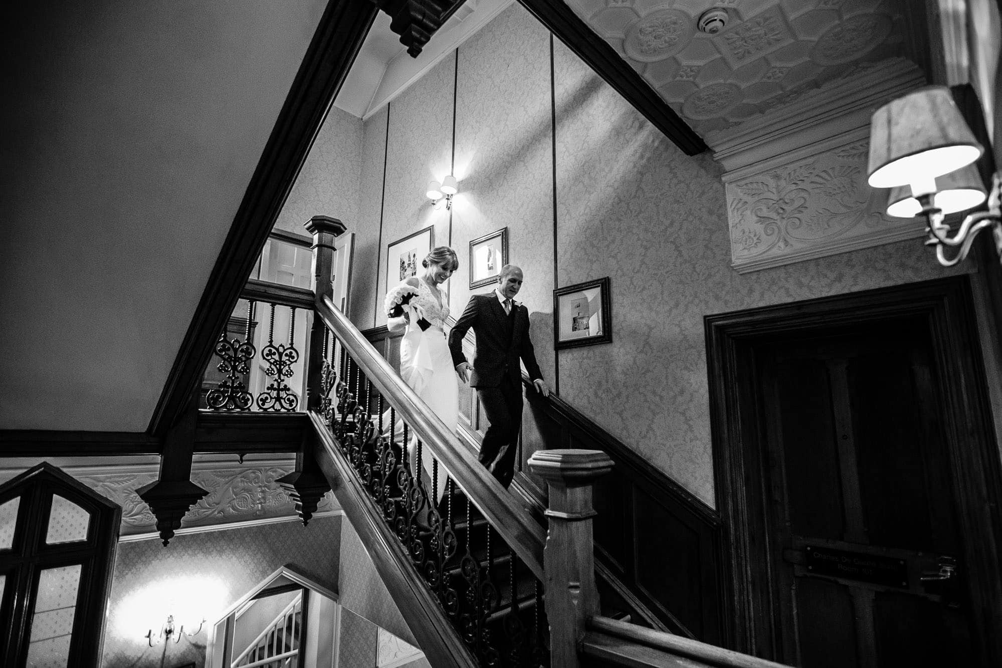 Bride and Groom on staircase at Oakley Court