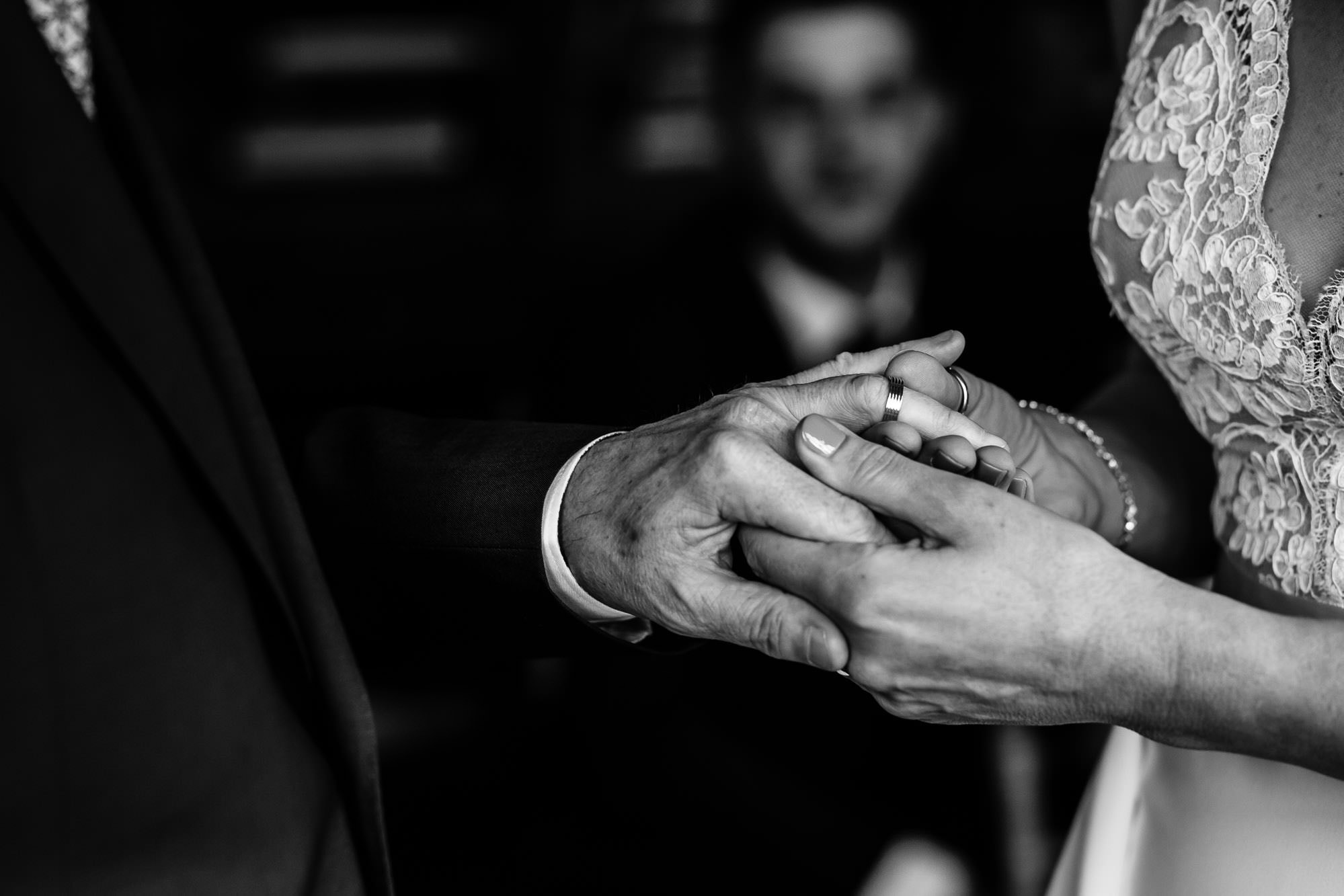 Bride putting on grooms ring during ceremony