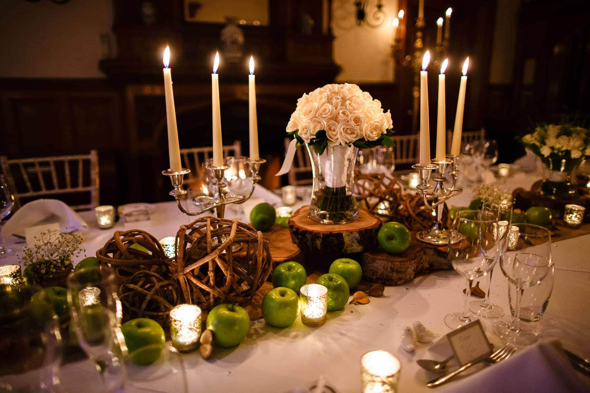 Candlelit Wedding Breakfast at Oakley Court Hotel, Berkshire with green apple decorations
