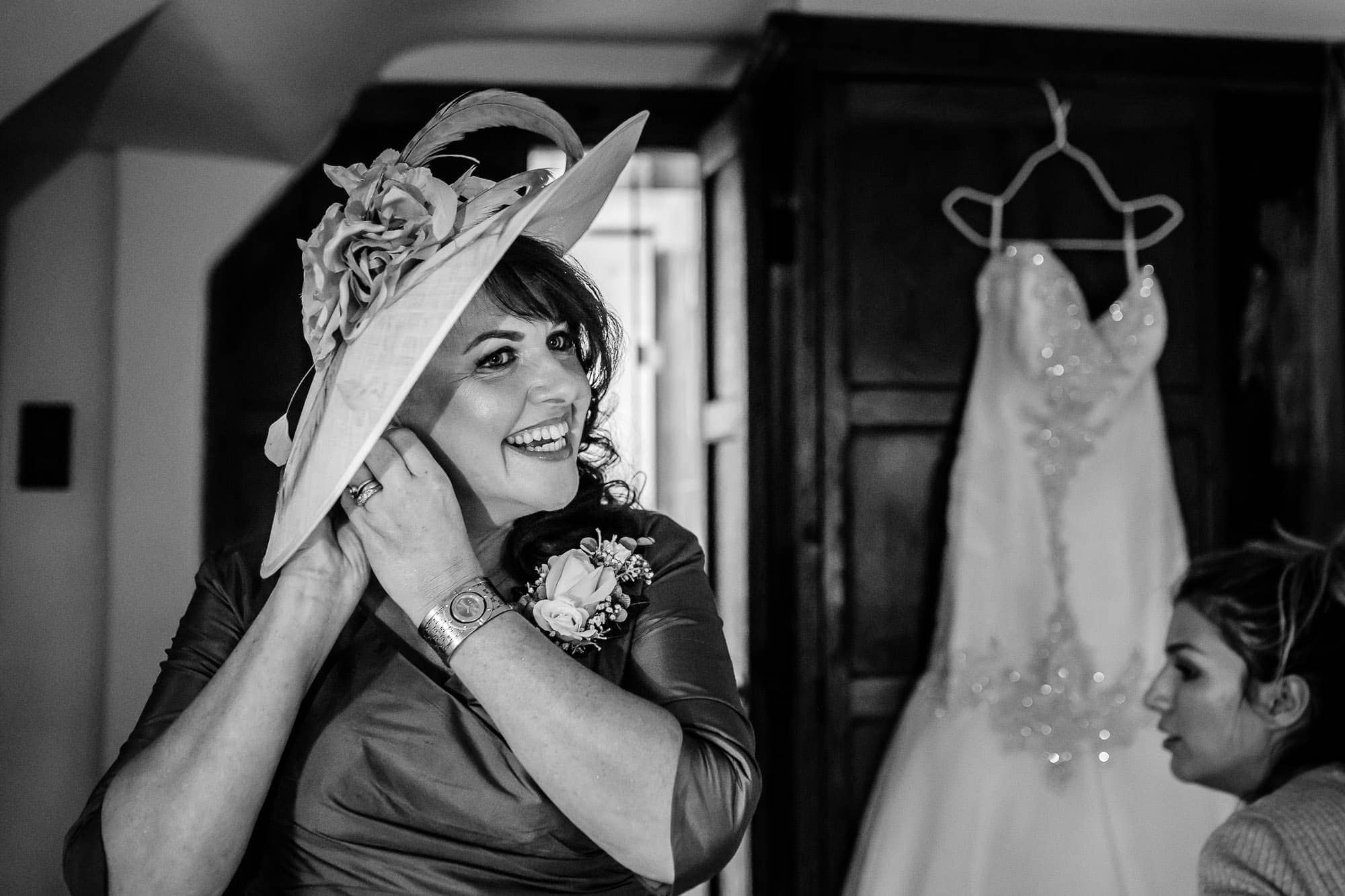 Laughing Mother of Bride Great Fosters wedding