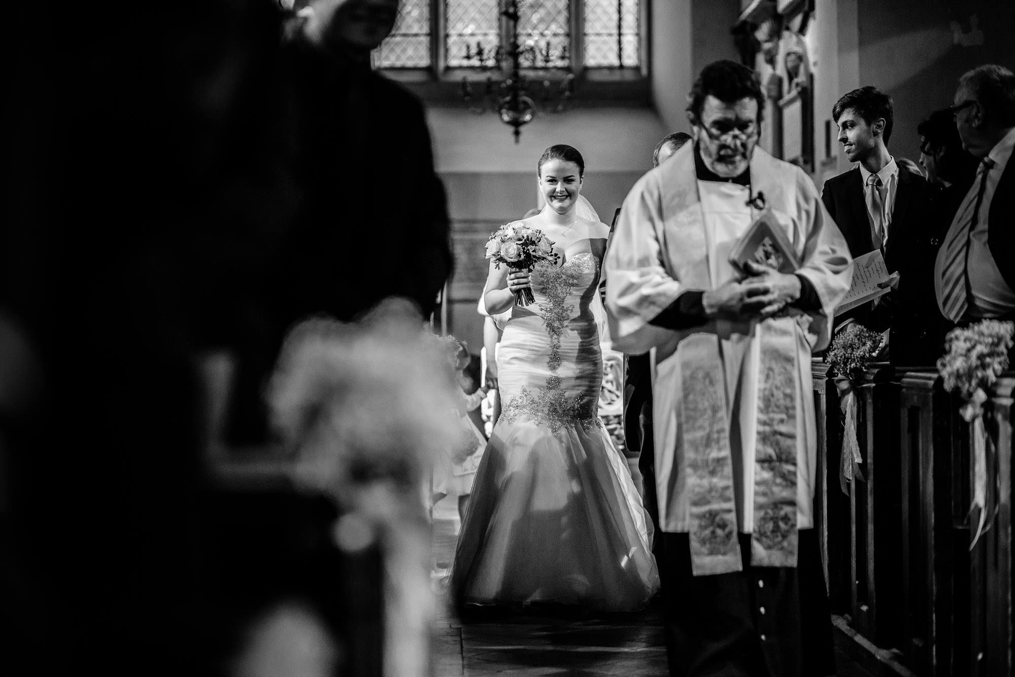 Bride walking down aisle at wedding St James Parish Church, Weybridge