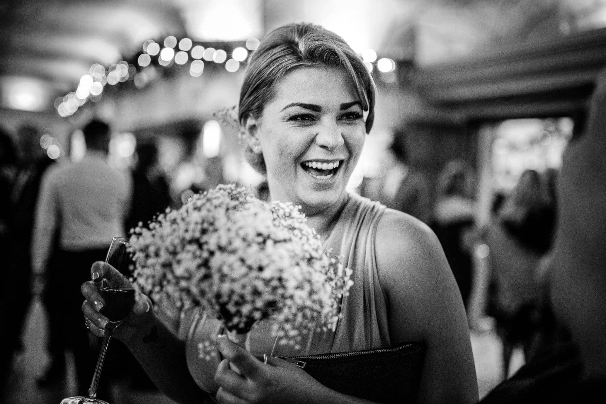 Laughing bridesmaid at Great Fosters Wedding Reception