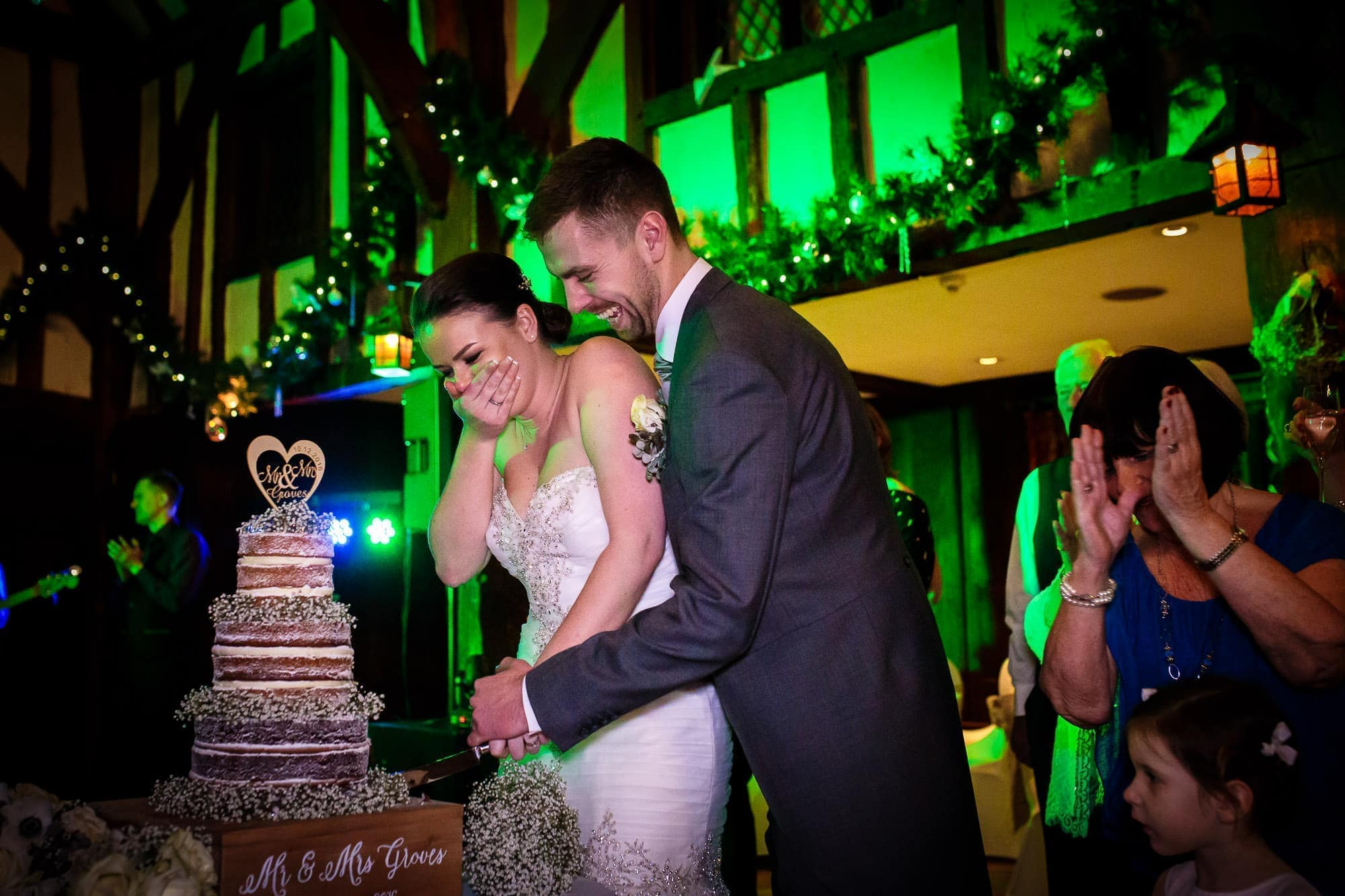 Cutting the cake - Great Fosters Wedding
