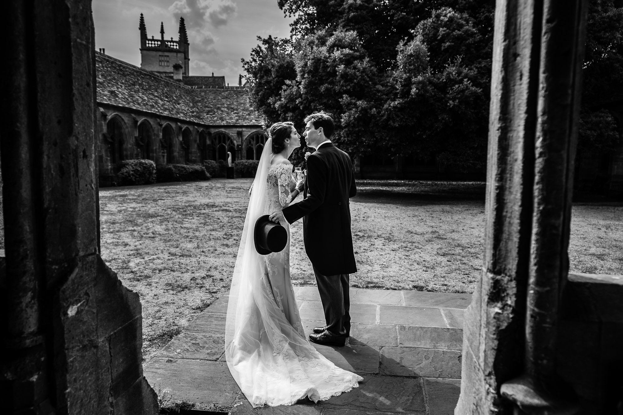 New College Chapel Oxford Wedding Photography - Private Kiss in the grounds of New College Oxford