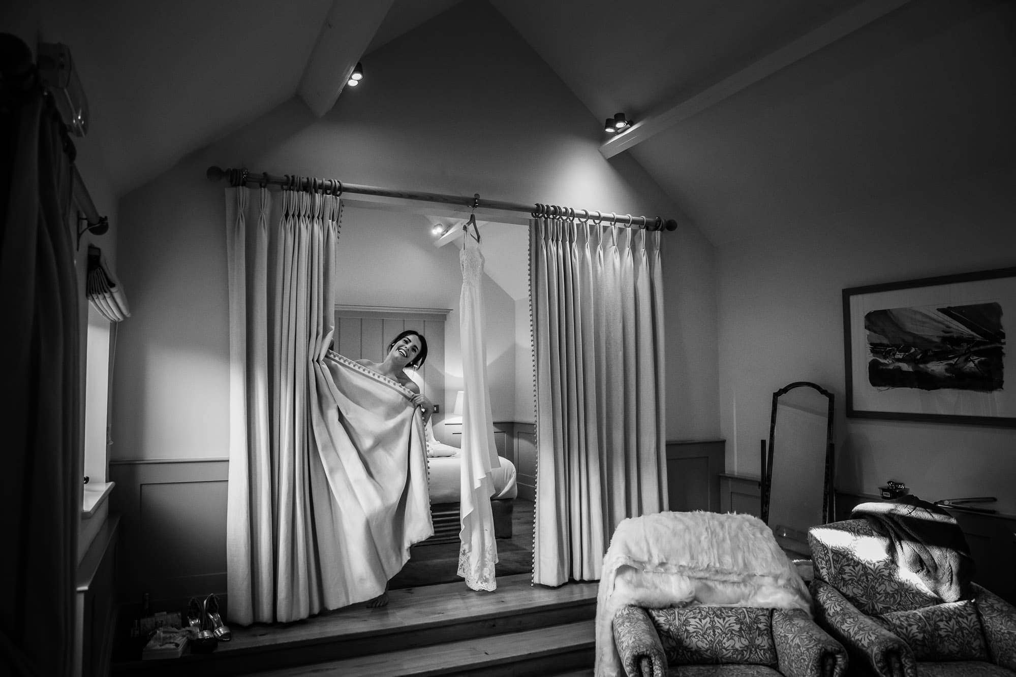 Bride hiding behind curtain - Farbridge Wedding - Bridal Preps