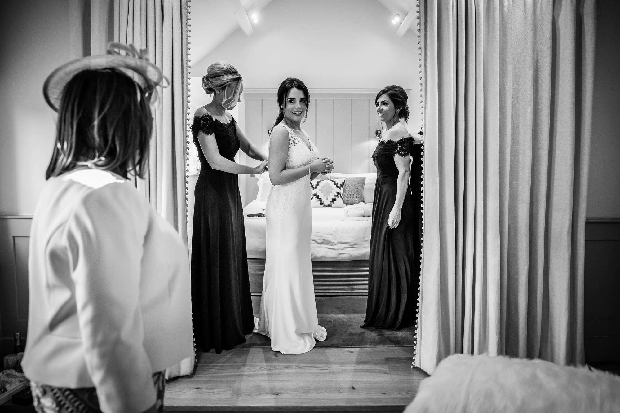 Bride getting into wedding dress, Bridal Prep - Farbridge Wedding