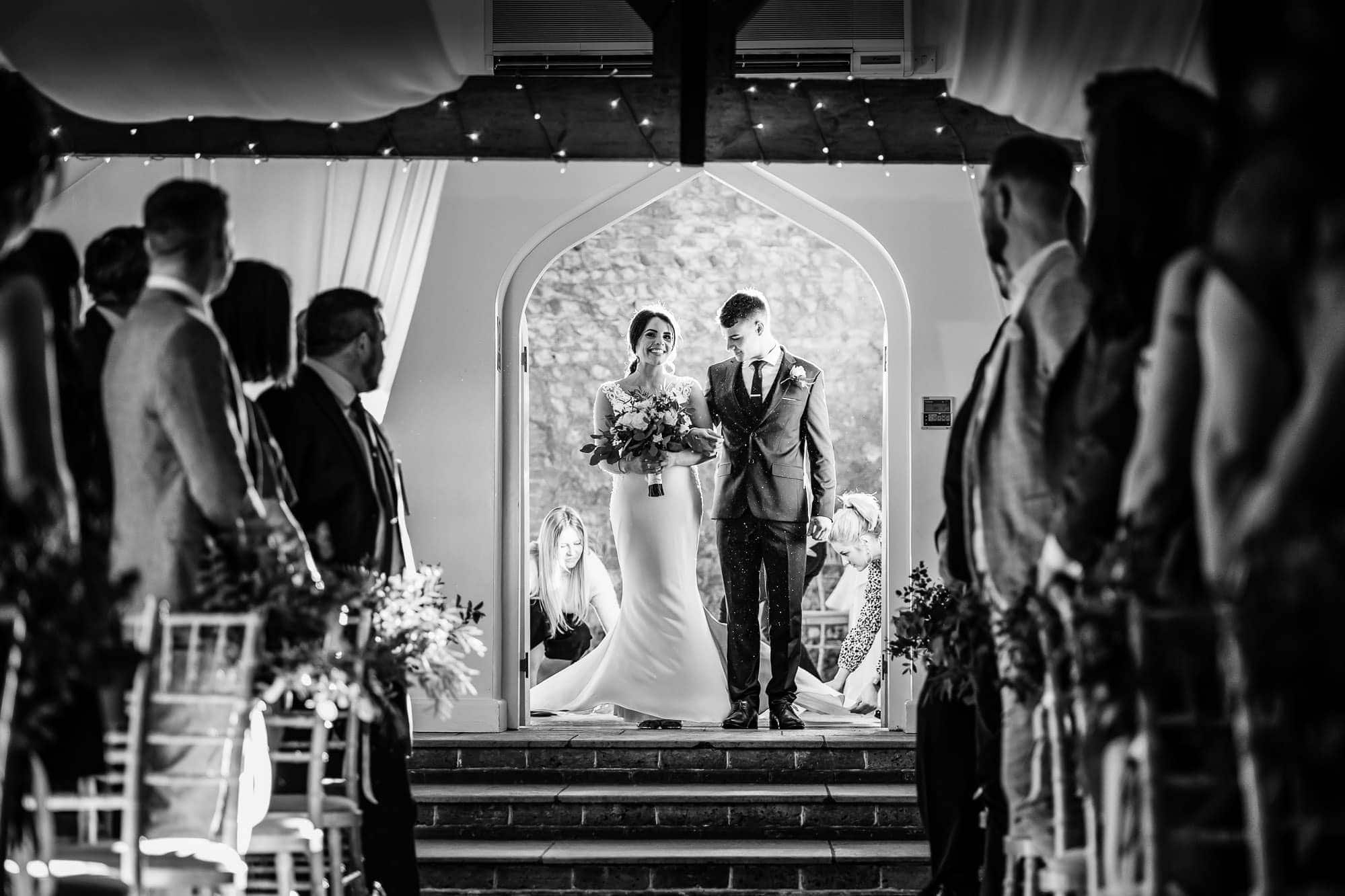Bride and her Brother waiting to walk down aisle - Farbridge Wedding Ceremony