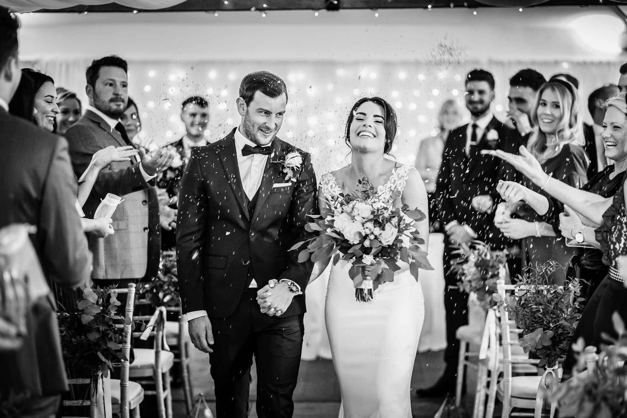Farbridge Wedding Photo - Wedding Ceremony - Confetti as couple walk down the aisle - Farbridge Wedding Photographers