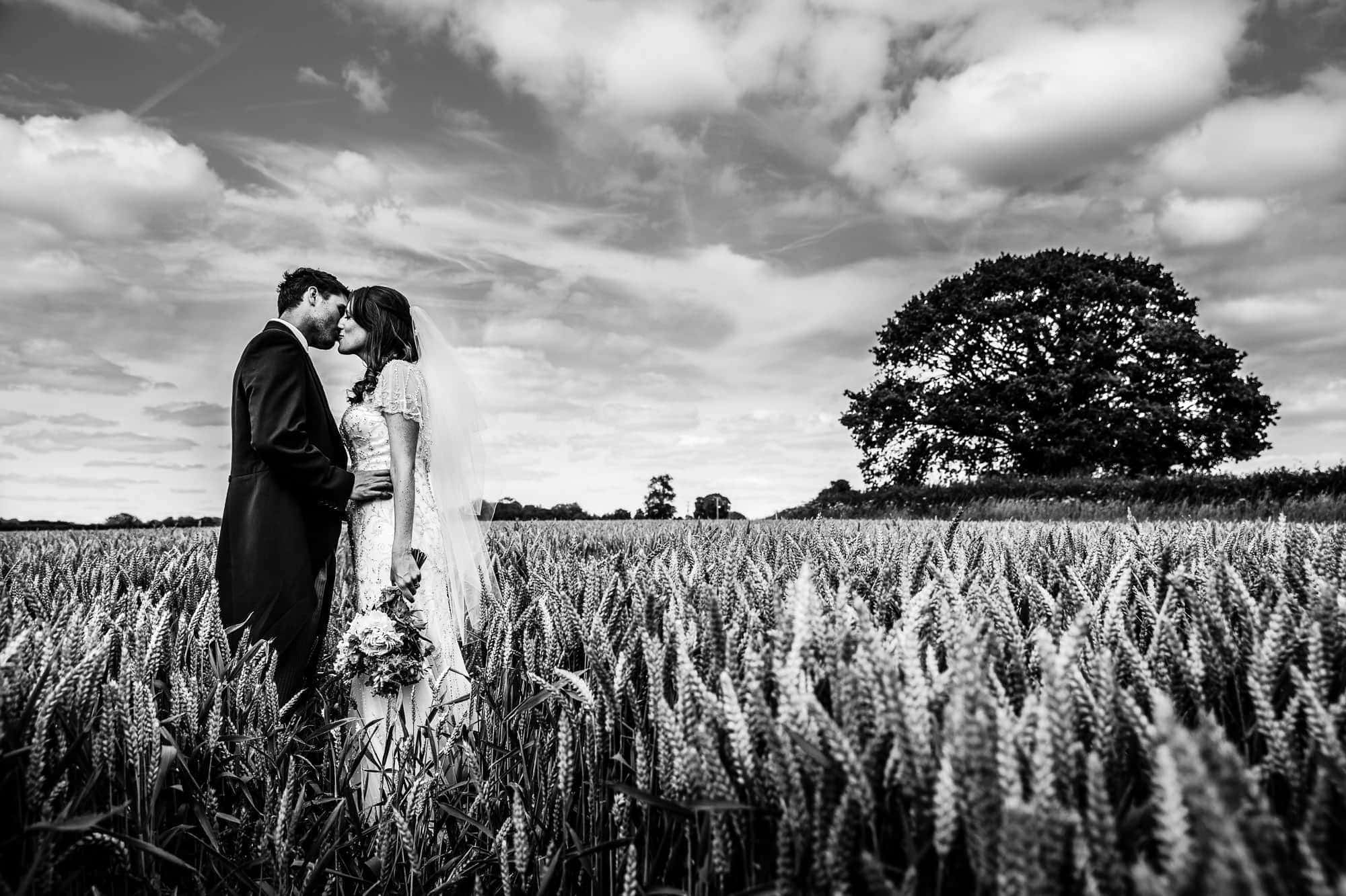 Tipi Wedding Hampshire - Wedding Couple Portraits in Corn Field by Tansley Photography