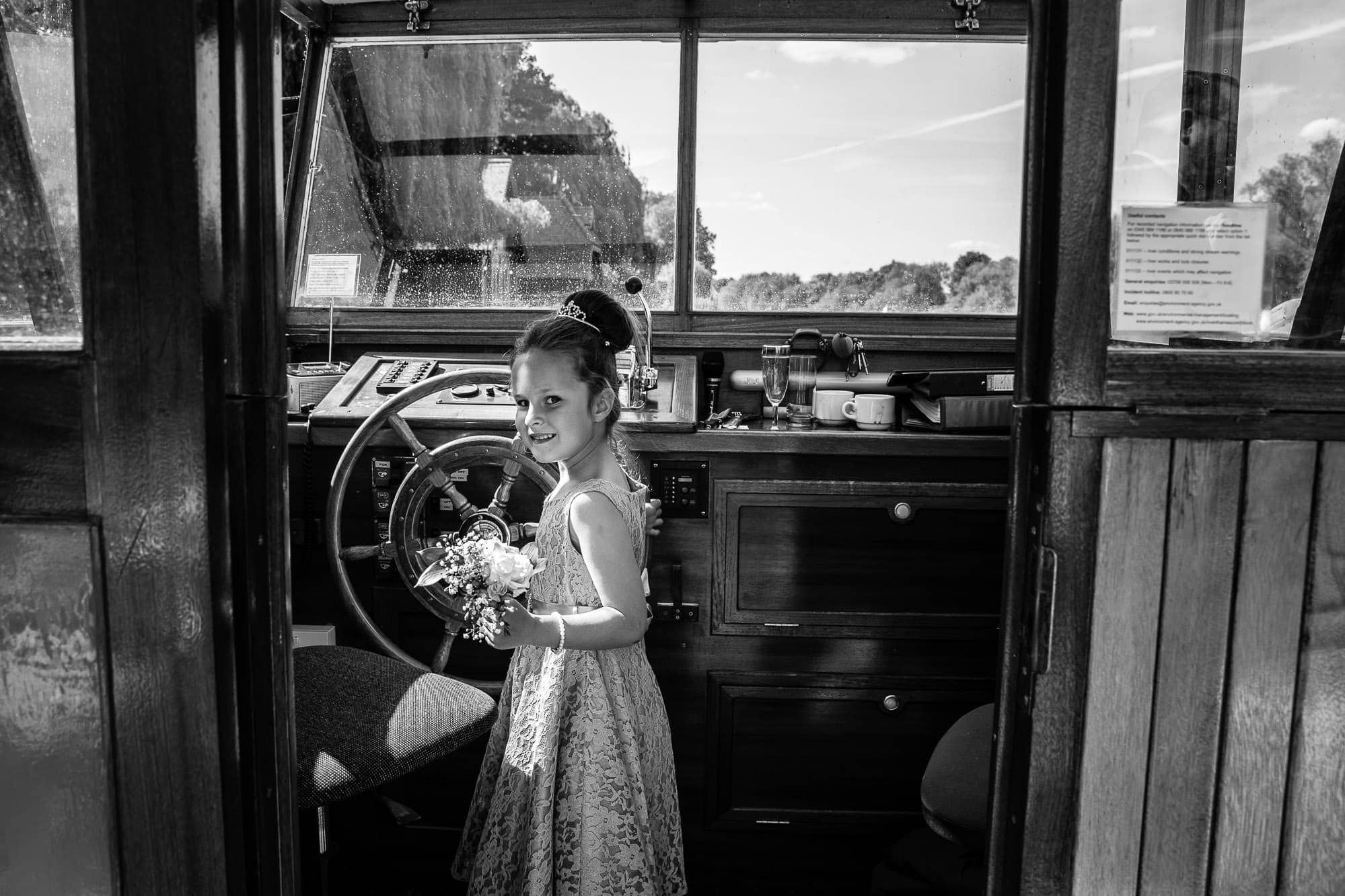 Flower Girl driving the boat