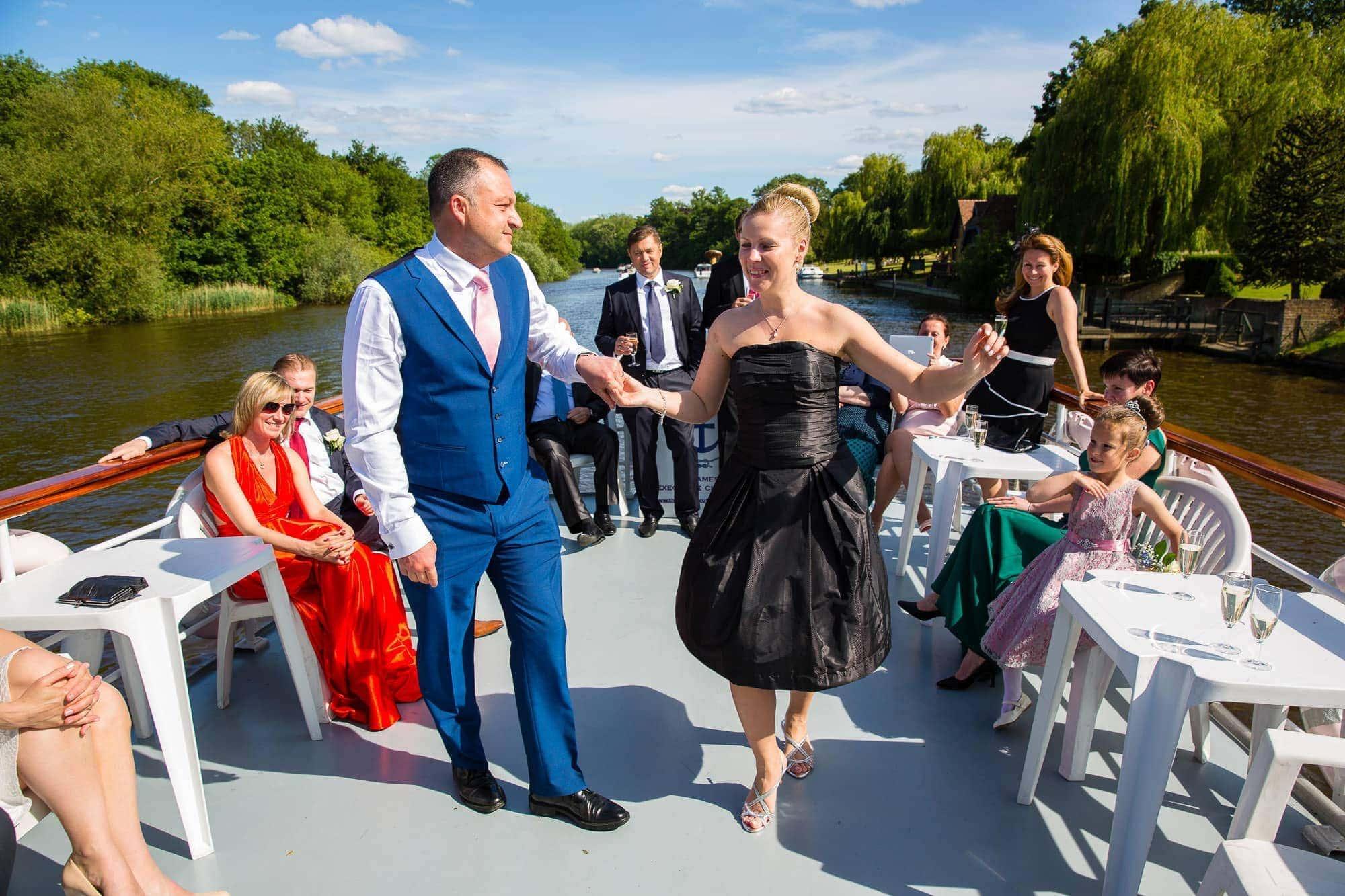 Dancing onboard boat at Oakley Court Wedding