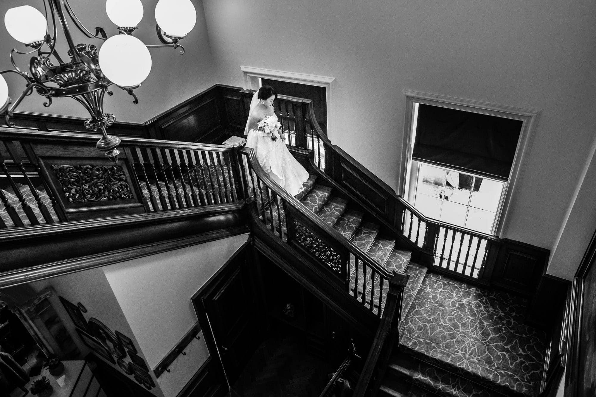 De Vere Wokefield bride walking down main staircase