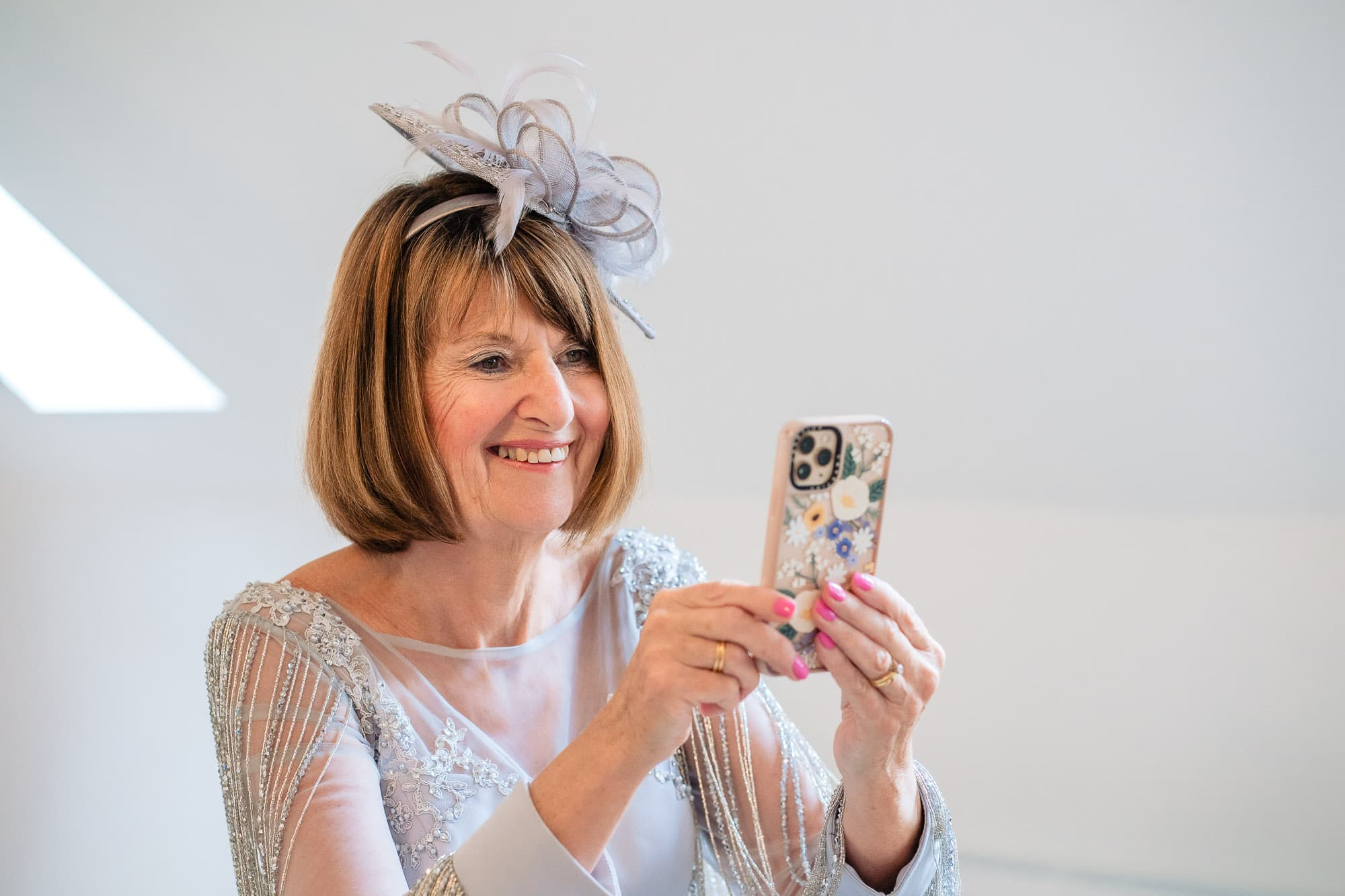 Mother of bride taking photo on her phone