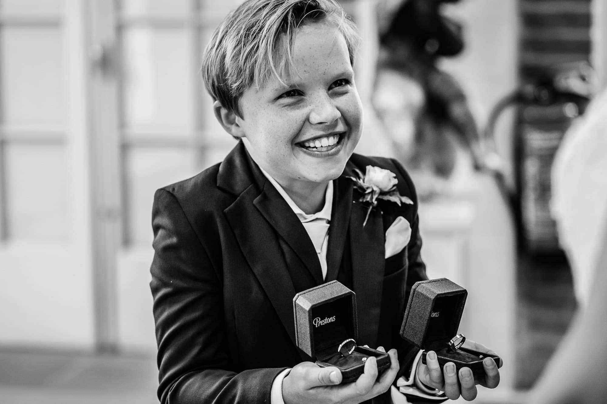 page boy with wedding rings