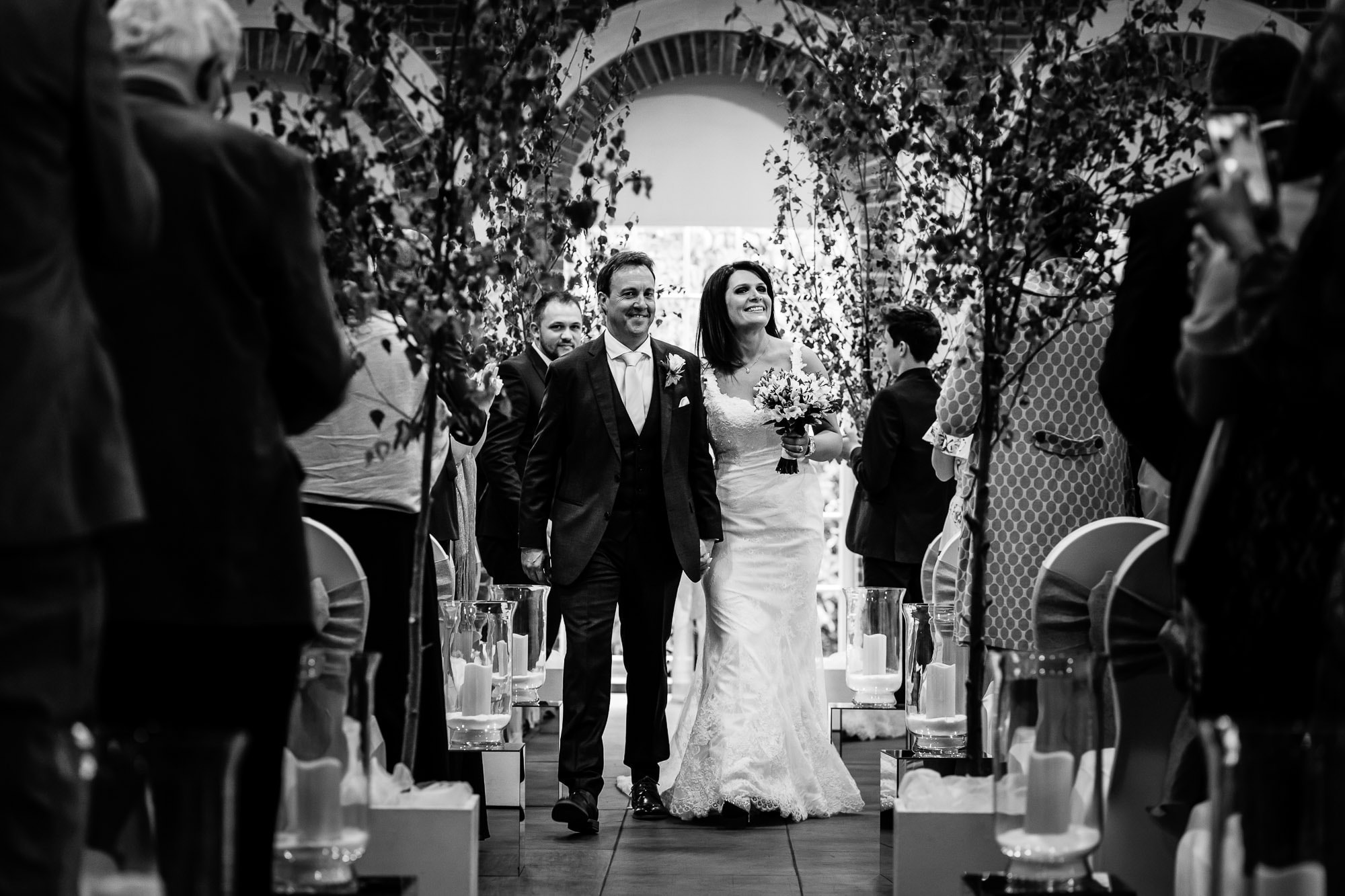 Couple walking down the aisle, Great Fosters Orangery wedding